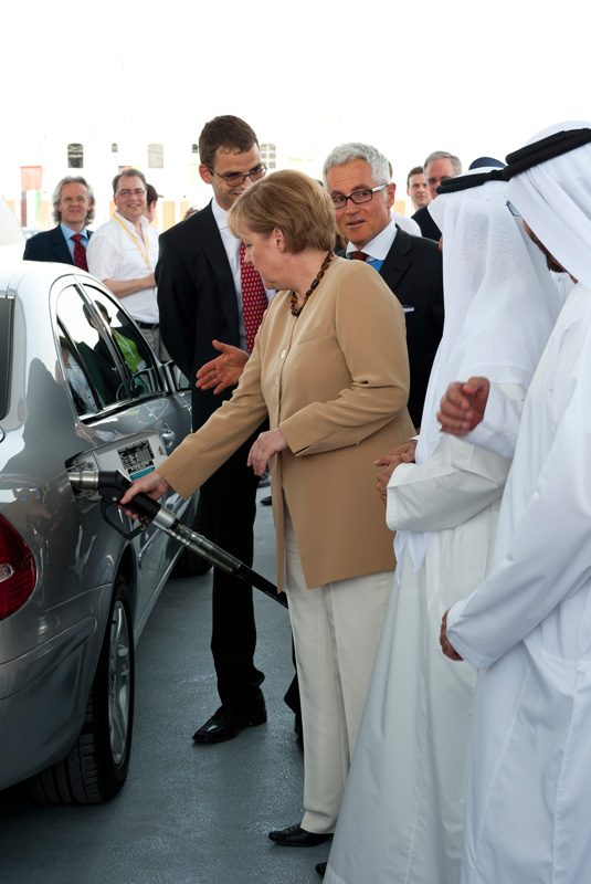 German Chancellor Dr. Angela Merkel and Philipp Bayat, managing director of the BAUER group refuelling a natural gas vehicle